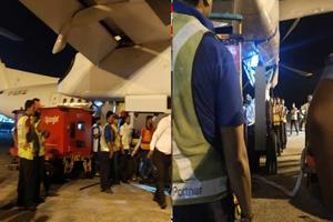 Khabar East:Big-accident-at-Kolkata-airport-trapped-technicians-neck-death-in-planes-landing-gear-gate