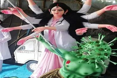 Khabar East:Mother-Durga-slaying-Coronasur-in-a-doctors-costume-in-a-metropolitan-pandal